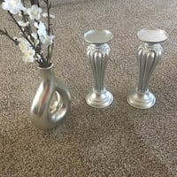 Two stainless steel candle holders.z Charlotte, 28210