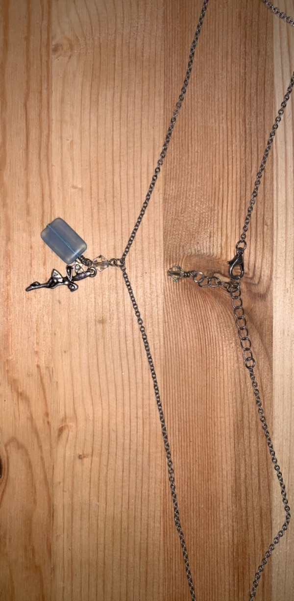 silver chain link necklace with cross pendant