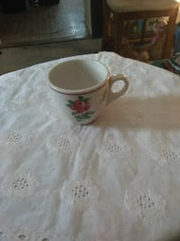 white, pink, and green floral ceramic teacup Cleveland