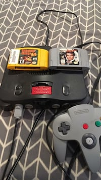 black Nintendo 64 console with controller and game cartridges Laurel, 39440