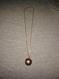 Gold chain and pretty red and butterfly pendant necklace