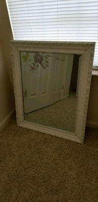 rectangular white wooden framed mirror