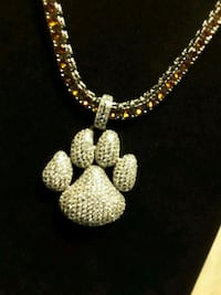 New The Iced-Out Paw & Orange Tennis Chain set $60 11/10 Ladson, 29456