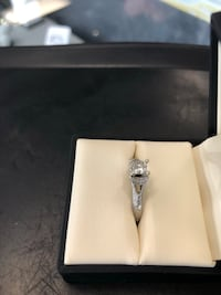 silver-colored ring with box 81 mi