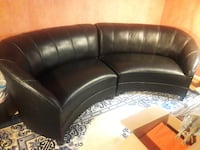 Two piece black leather sectional Art Deco Reston