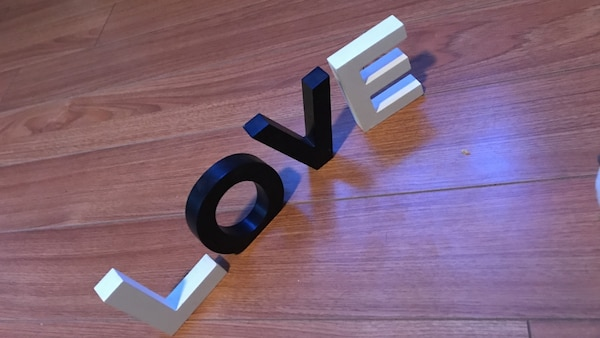 white and black letter love table decor