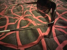 pair of black Southpole sunglasses