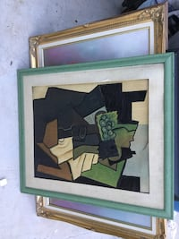 black and brown abstract painting with gray frame