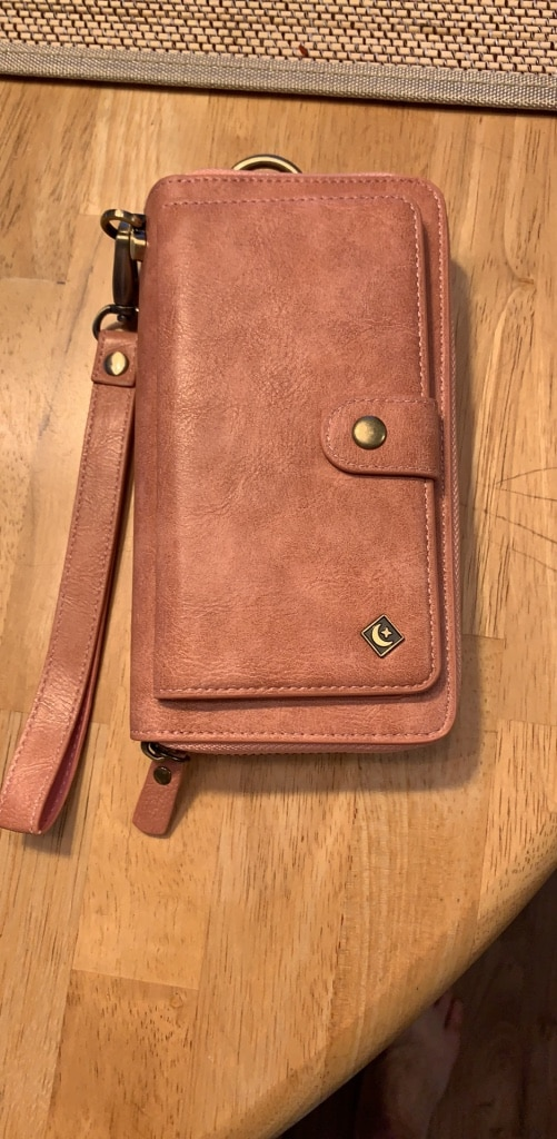 Woman's wallet holds a iPhone eight
