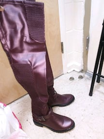 Pair of maroon leather thigh-high boots