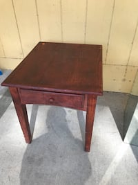 Brown wooden single drawer side table