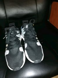 pair of black-and-white Nike running shoes Edmonton, T6L 5S4