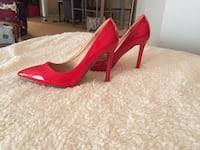Red patent leather pointed toe stilettos