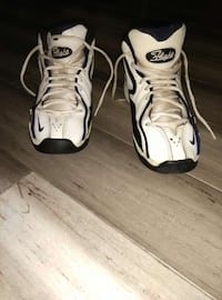 pair of white-and-black Nike Flight basketball shoes
