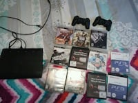 PlayStation 3 with games and controllers