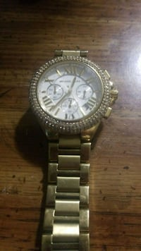 round silver-colored chronograph watch with link b Morinville, T8R 0A3