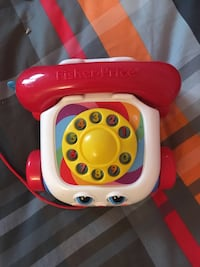 white, yellow and red Fisher Price rotary phone toy Granby, J2G