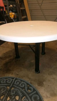 """plastic round patio table with steel legs  42"""" in  Kitchener"""