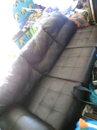 4 Ft long leather chocolate couch  Palmdale, 93551