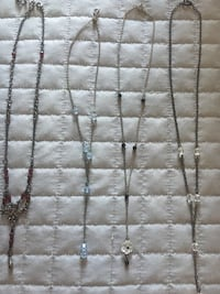 Four silver-colored chain necklaces $5.00 each Mississauga