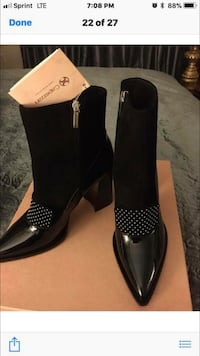 pair of women's black patent leather pointed-toe boots with box screenshot