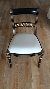 Black and gold hand painted padded wooden chair