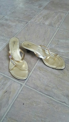 pair of gold-colored chunky kitten sandals