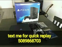 black Sony PS4 console with controller and box San Francisco
