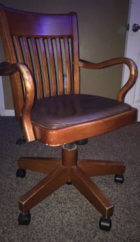 brown wooden framed black leather padded rolling chair Bakersfield, 93311