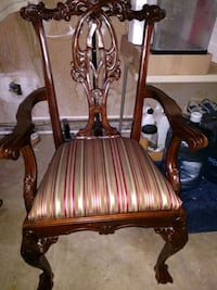 brown wooden framed brown padded armchair Sterling