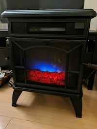 Electric heater faux fireplace