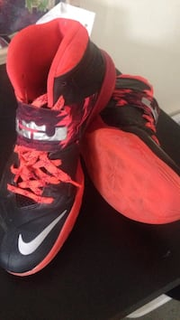 pair of black-and-red Nike LeBron basketball shoes