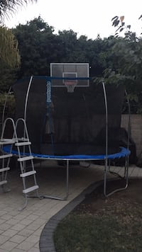 Blue and black trampoline with enclosure San Jose, 95136