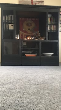 Black wooden tv hutch with flat screen television Sacramento, 95828