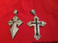 Black and silver cross shaped pendant nice