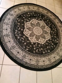 Nice round black and grey Turkish rug.  Whitby, L1N 9E2