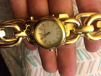 round gold-colored analog watch with link bracelet Cornwall, 12518