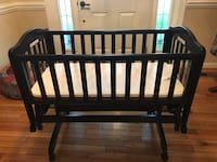 Baby's brown wooden rocking crib 11 km