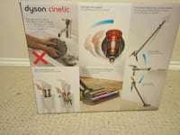 red and black Dyson Cinetic canister vacuum cleane