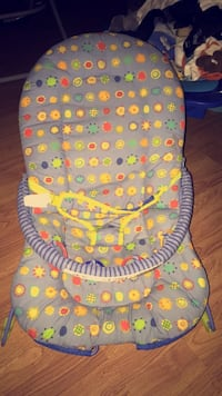baby's gray, yellow, and green bouncer seat