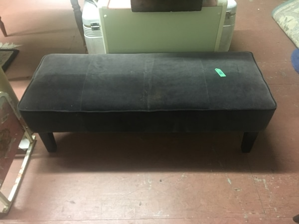 black wooden framed glass top coffee table 397c92d3-9b10-4d36-8919-36a4baf33542