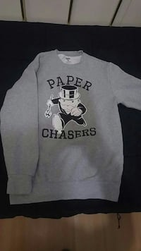 gray and black Paper Chasers print crew-neck sweater