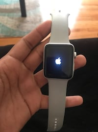 silver aluminum case Apple Watch with white sport band 587 mi