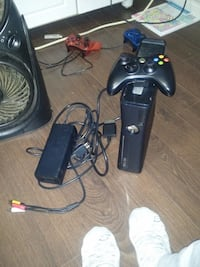 black Xbox 360 console with controller Winnipeg