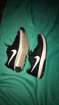 pair of black-and-white Nike running shoes East Syracuse, 13057