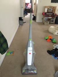 gray and white Hoover upright vacuum cleaner for hard wood floors or tile