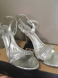 pair of silver-colored open-toe heels Toronto, M9C 1G8