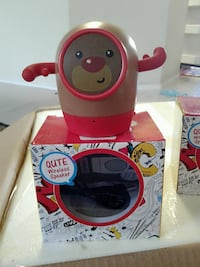 red and brown Qute wireless speaker with box