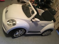 toddler's white Volkswagen Beetle ride-on toy
