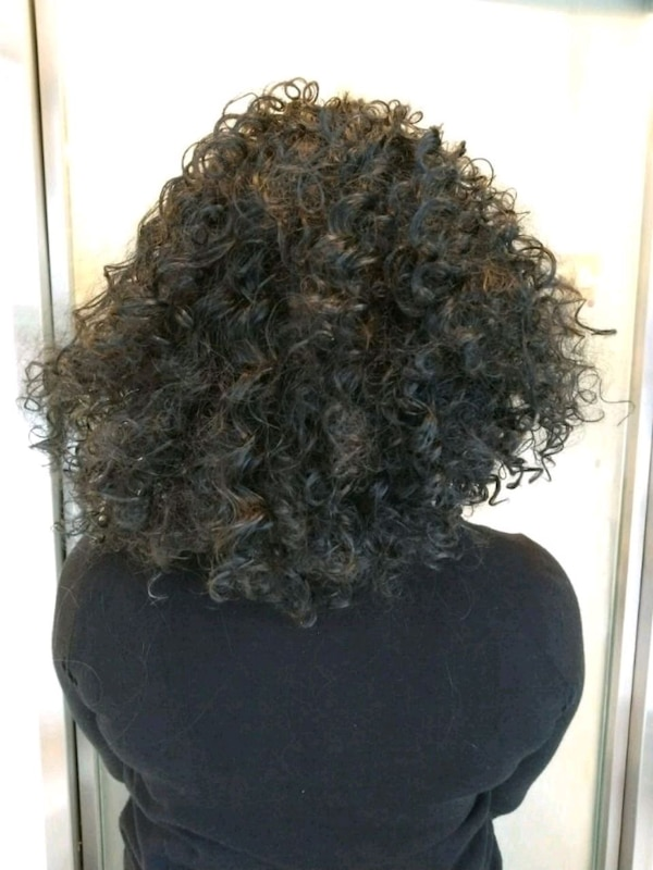 Brand new super curly wig 556b21a8-774b-46a8-b799-8cc67a8cdf99